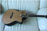 single cut solid acoustic guitar